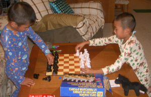 Zheng Brothers Playing Chess in their Pajamas